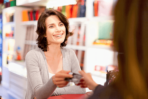Image of a woman handing out her business card.